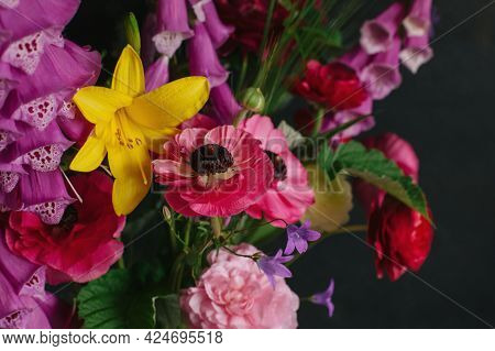 Beautiful Summer Flowers On A Dark Background. Selective Focus.
