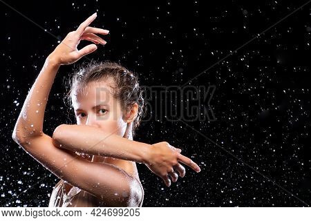 Portrait Of Sports Woman Doing Stretching Under Drops Of Rain. Girl Dancer Is Dancing. Drops Of Wate