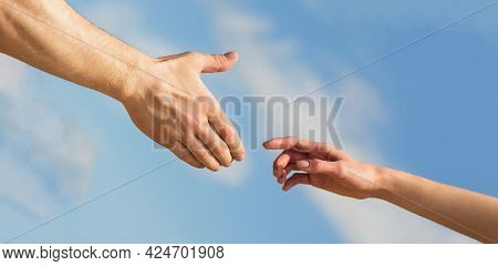 Lending A Helping Hand. Solidarity, Compassion, And Charity, Rescue. Hands Of Man And Woman Reaching