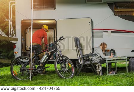 Caucasian Family Rv Camping Time. Father And His Daughter In Front Of Their Rental Rv Camper Van. Mo