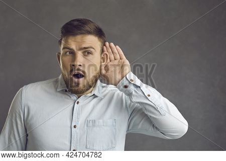 Curious Man Puts Hand To Ear Listening To Shocking News Or Eavesdropping On Somebodys Secret