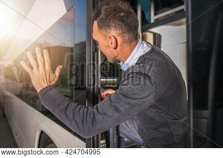 Elegant Caucasian Men Waving To Someone Leaving Bus Station In A Vehicle. Goodbye Hand Gesture. Busi