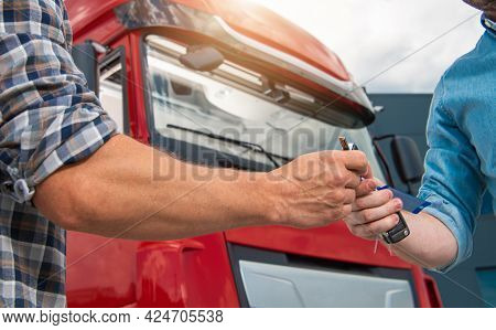 Caucasian Semi Truck Drivers Shift Work Vehicle Keys Transfer. One Driver Giving Tractor Key To His