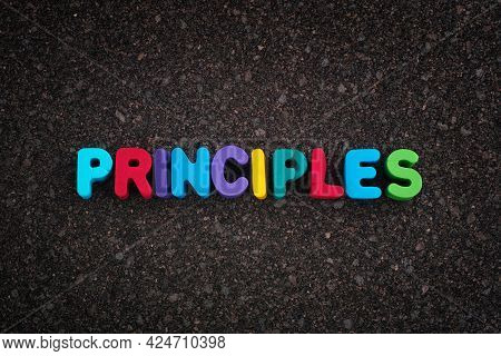 The Word Principles On A Dark Cork Board. Close Up.