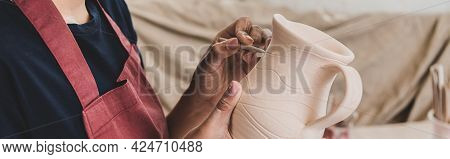 Partial View Of Young African American Woman Sculpting Clay Pot With Stick In Pottery, Banner