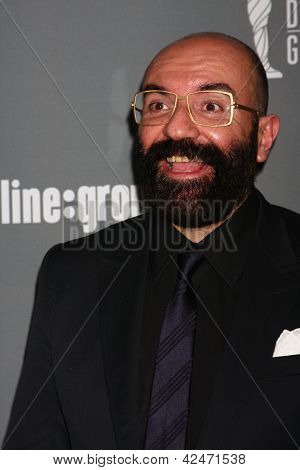 LOS ANGELES - FEB 19:  Paco Delgado arrives at the 15th Annual Costume Designers Guild Awards at the Beverly HIlton Hotel on February 19, 2013 in Beverly Hills, CA