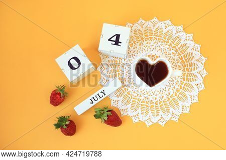 Calendar For July 4 : Cubes With The Numbers 0 And 4, The Name Of The Month Of July In English, A Cu