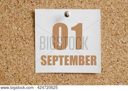 September 01. 01th Day Of The Month, Calendar Date.white Calendar Sheet Attached To Brown Cork Board