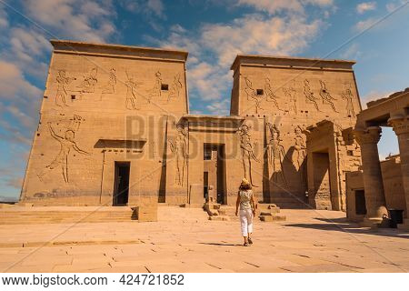 A Young Tourist Visiting The Temple Of Philae, A Greco-roman Construction Seen From The Nile River,