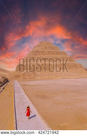 A Young Woman Visiting The Stepped Pyramid Of Djoser, Saqqara. Egypt. The Most Important Necropolis
