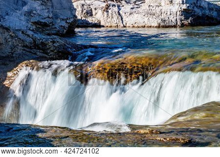 Flowing Waters Of The Elbow River Crash Against The Rocks. Elbow Falls Provincial Recreation Area, A