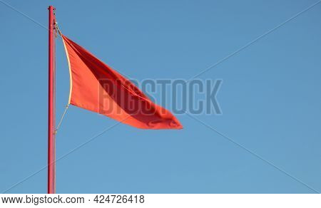 Big Red Flag Symbol Of Emergency Or Danger Sign With The Background Of The Blue Sky
