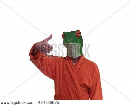 Young Boy Wearing A Green Frog Animal Mask With Orange Bathrobe With Surfing Hand Gesture With Pinky