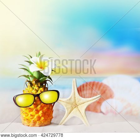 Pineapple With Flower And Seashells In The Beach. Summer Beach Concept.