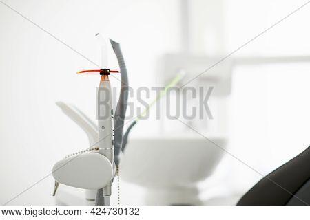 Endodontic Instruments On White. Dental Polymerization Uv Lamp. Uv Tool.