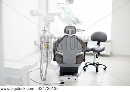 Dentist's Office Interior With Modern Chair And Special Dentisd Equipment. Dentist Office. Dentist C