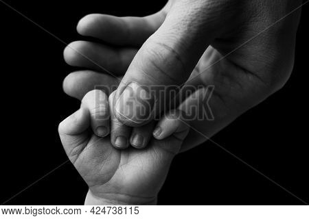 Father Holding Newborn Babys Fingersnewborn . Hand Of A Newborn Baby. Hands Of Parents And Baby Clos