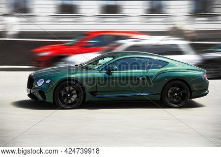 Kiev, Ukraine - June 19, 2021: Luxury British Bentley Continental Gt Car In Motion. Blurred Car. Sup