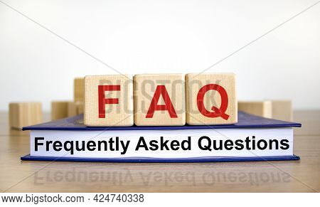 Faq Frequently Asked Questions Symbol. Concept Words 'faq Frequently Asked Questions' On Wooden Cube