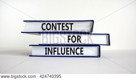 Contest For Influence Symbol. Books With Words 'contest For Influence'. Beautiful White Background.