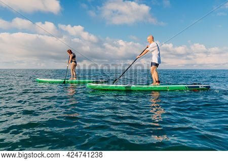 June 13, 2021. Anapa, Russia. Couple On Stand Up Paddle Board At Quiet Sea. People Traveling On Tour
