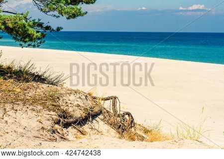 Summer Landscape. A Lonely Beach With White Sand And Blue Sea. View Of Baltic Sea Coast.  Hel Penins