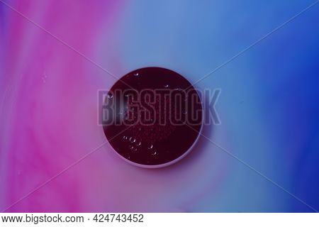 Abstract Colors, Backgrounds And Textures. Food Coloring In Milk. Food Coloring In Milk Creating Bri