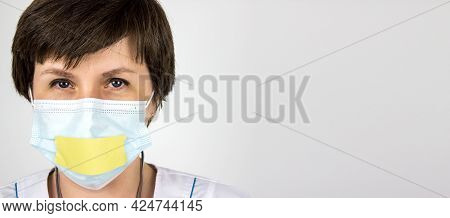 Truth About 2019 Novel Coronavirus 2019-ncov . Medical Secrecy Concept. Woman Doctor With Taped Lips