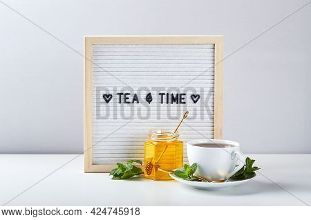 Tea Time. White Letter Board With Text On Marble Table With Glass Cup Of Tea With Mint Leaves