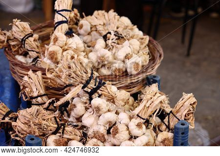 Bundles Of Garlic For Sale In The Turkish Bazaar, Alanya, April 2021