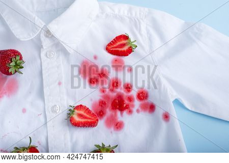 Complex Strawberry Spot On A White Shirt. Isolated. High Quality Photo