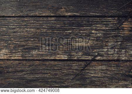 Close-up Old Vintage Dark Rough Hardwood Natural Wooden Surface Background. Empty Oak Plank Wood Abs