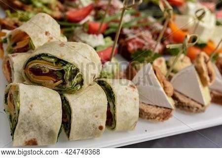 Selective Focus. Several Pieces Healthy Fresh Chicken And Salad Wraps. Fresh Tortilla Wraps With Sal