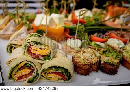 Several Pieces Healthy Fresh Chicken And Salad Wraps. Fresh Tortilla Wraps With Salads And Cheese An