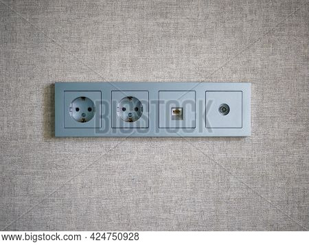 Close-up Of A Gray Four Module Socket. Double Electrical Socket, Ethernet Socket And Tv Socket.