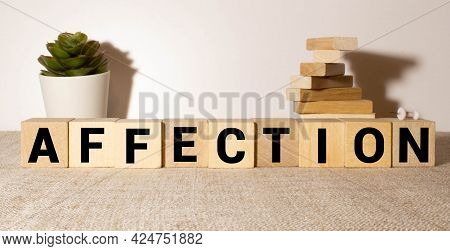 Word Affection Is Made Of Wooden Building Blocks Lying On The Table And On A Light Yellow Background