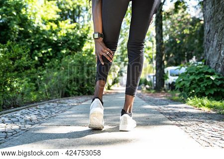 Calf Injury And Cramp Pain. Sport Athlete Jogging