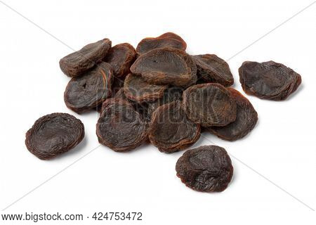 Heap of dried South African sour apricots isolated on white background