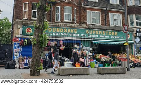 LONDON,  UK- 22nd June 2021: Discount store in high street, Barking, East London.