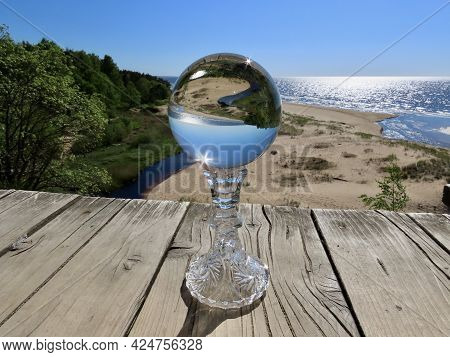 Wooden Platform By Steep And High Sand Dune On Baltic Sea Coast With Lensball On Candleholder. Place