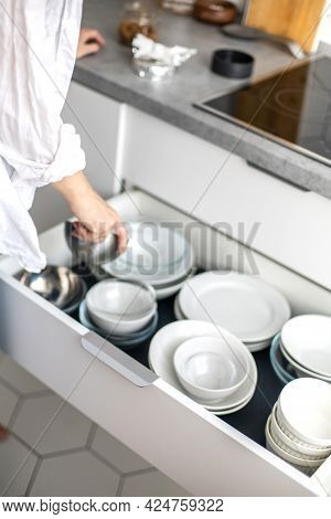 Comfortable White Gray Kitchen Interior Open Box Full Of Various Crockery Porcelain Or Glass Plates