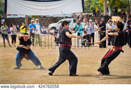 Lamphun, Thailand - April 12, 2019: Men Perform Martial Art With Stick In Lanna Northern Style On So