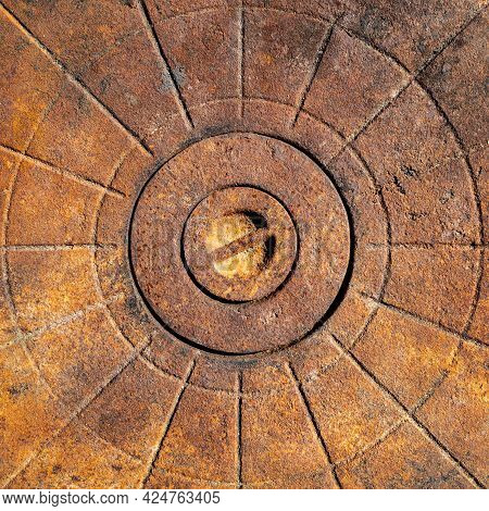 An Old Rusty Cast-iron Surface With A Relief Pattern In The Form Of Lines And Circles. Flat Layout.