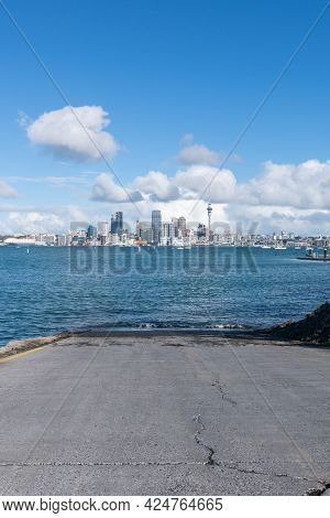Auckland City Skyline Beyond Stanley Bay Boat Launching Ramp And Harbour In Vertical Composition,  N