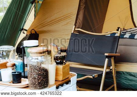 Camper Picnic Tent Campground In The Outdoor Hiking Forest. Coffee And Stove Equipment On Camping Ta