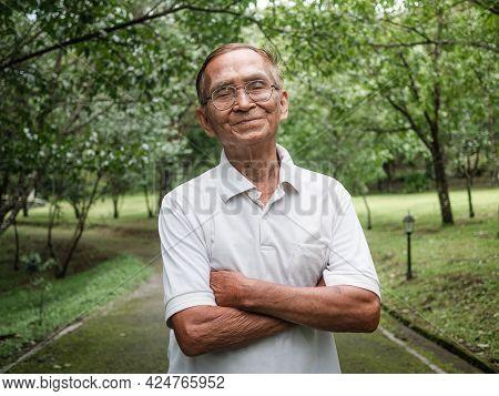 Portait Of Senior Man Enjoying Nature In The Park. Senior Retired Man Enjoying The Freedom Of Retire