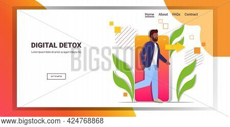 Man Coming Out Of Cellphone Digital Detox Concept Guy Escaping From Digital Addiction