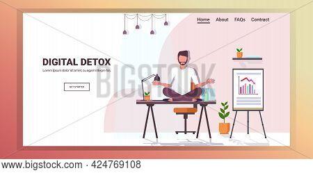 Businessman Sitting Lotus Pose On Workplace Table Digital Detox Concept