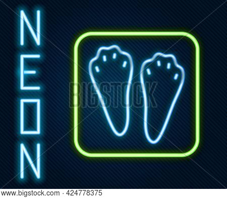 Glowing Neon Line Rabbit And Hare Paw Footprint Icon Isolated On Black Background. Colorful Outline