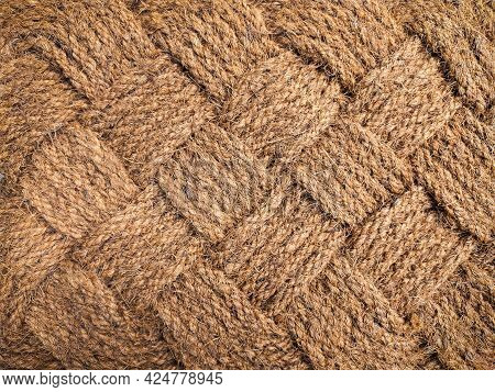 Jute Rug Close-up. The Jute Weave Is Close. A Fragment Of A Large Weaving With A Rhombus, Background